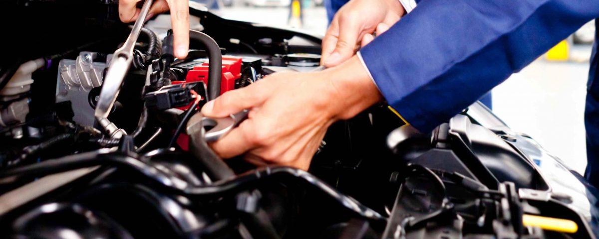 certified auto mechanic repairing engine